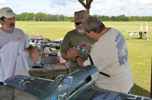 Robert is wiping a P-51,s excess from his face, as Jerry inspects a aricraft for repairs AFTER crashing into Robert!