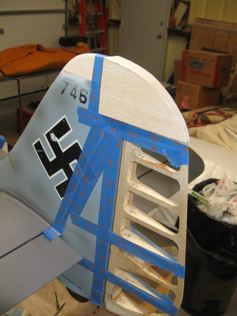 Blue fasten over a rudder to keep sanding outlines off those areas while moulding a rudder top. Also blue fasten to keep rudder ideally inline with gash while sanding.